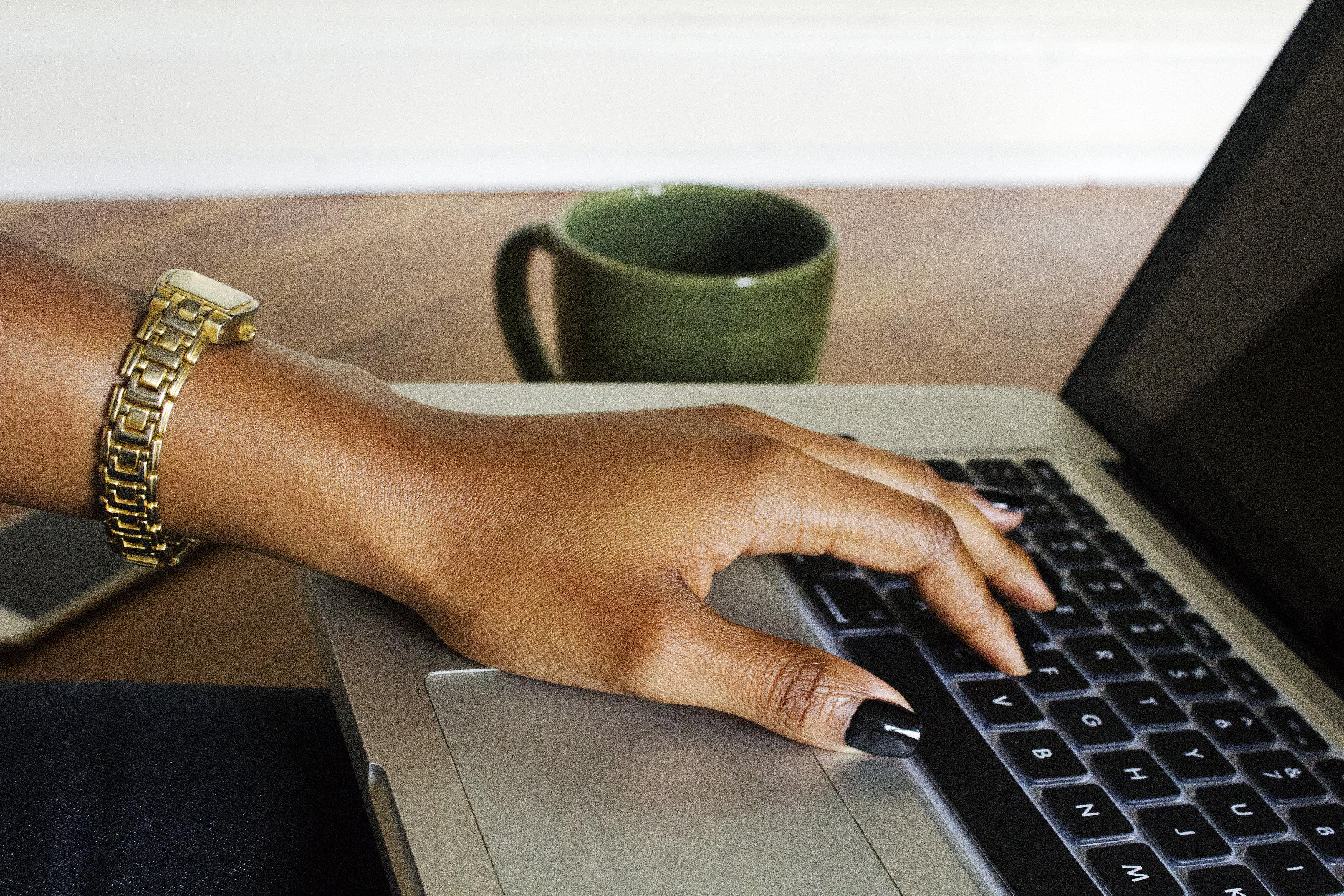 black-woman-hand-on-laptop-createherstock